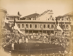 Wrestling matches in old Rajwada, [Kolhapur, watched by large crowds including the Maharaja].